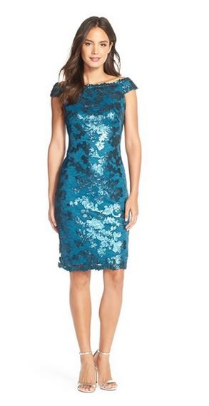 Off the shoulder sequin cocktail dress Shimmering with sequins throughout a lace overlay, this off the shoulder cocktail dress is both elegant and vibrant