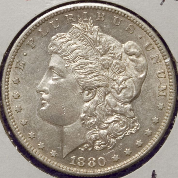 Un antigua y autentica moneda MORGAN Dolar 1880 S (San Francisco). Condicion - MS Gema (Acabado espejo) Tono lijera. SEMI-ESCASA. 1 Onza de Plata. Ley .900 Acunado en EEUU.