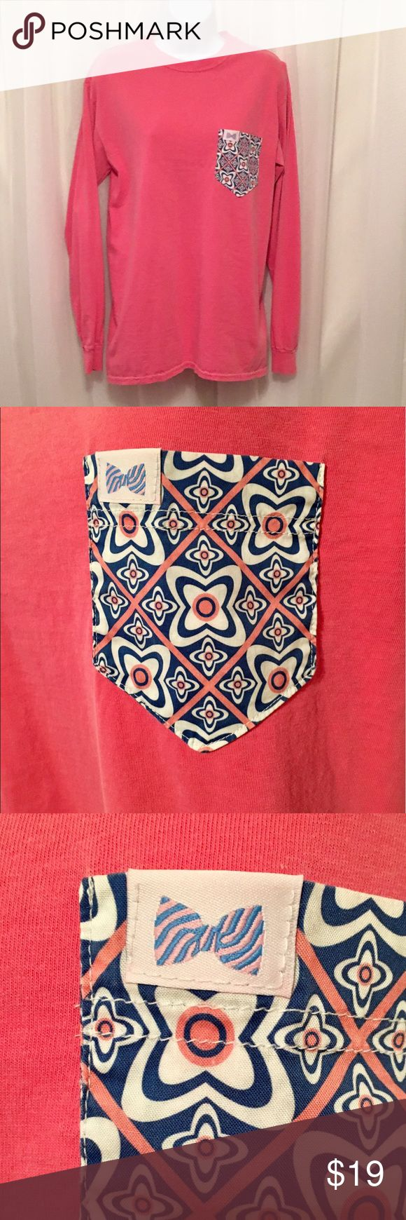 Fraternity Collection LS Tee Fraternity Collection brand, Long sleeve pink tee with pocket. Size s. Has pink, blue and cream abstract pocket on front. Very popular with the college crowd. A must have! Fraternity Collection Tops Tees - Long Sleeve