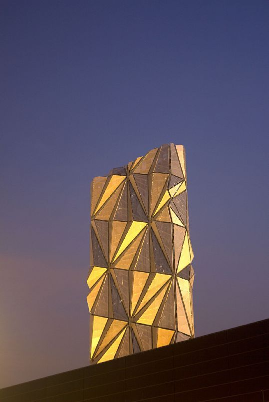 The Optic Cloak flues stack of the Greenwich Peninsula Low-Carbon Energy Centre in London, by artist Conrad Shawcross and C.F. Møller Architects.