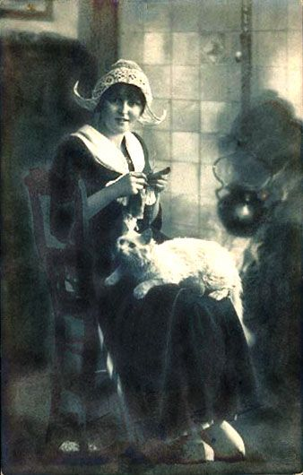 dutch woman with a white cat on lap