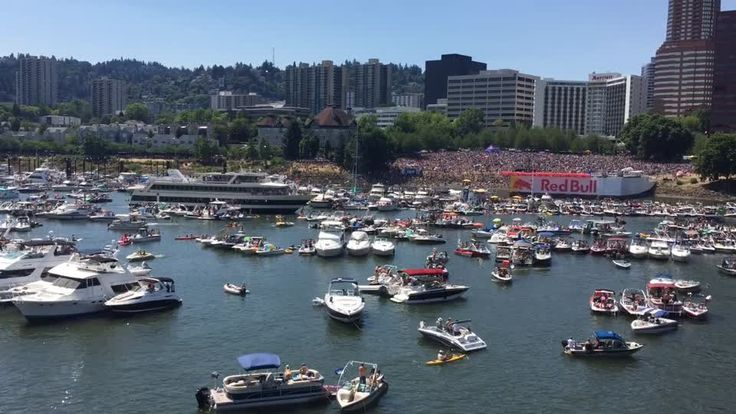 The Portland Spirit is escorted through a throng of boats gathered on the Willamette to watch the Red Bull Flugtag event.