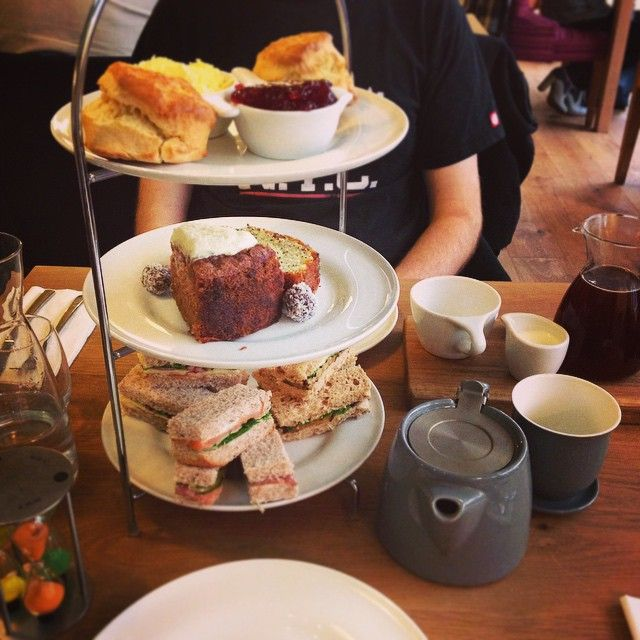 Afternoon tea at Wyndham Tea (Waterloo Tea) Cardiff. Sandwiches: Smoked salmon and cream cheese | Hummus and aubergine | Cheddar and pickled onion chutney. Cakes: Sweet potato and berry | Lemon and poppyseed. Scones with clotted cream and jam. Americano and a peony tea. Best ever! Take me back!