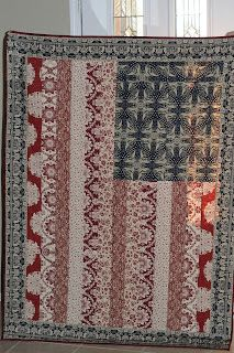 American Flag quilt...but you'd have to know if you're hanging it lengthwise or crosswise so you'll know which corner to put the blue in.