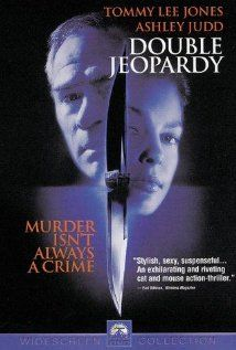 """Double Jeopardy (1999)  Stars: Tommy Lee Jones, Ashley Judd, Benjamin Weir When Nick Parsons appears to be murdered his wife Libby is tried and convicted. Six years later Libby is paroled and with the help of Travis Lehman (her parole officer) she sets out to find her son and the truth behind the """"murder"""". Written by Les  MacDonald at <mcmac@mb.sympatico.ca>"""