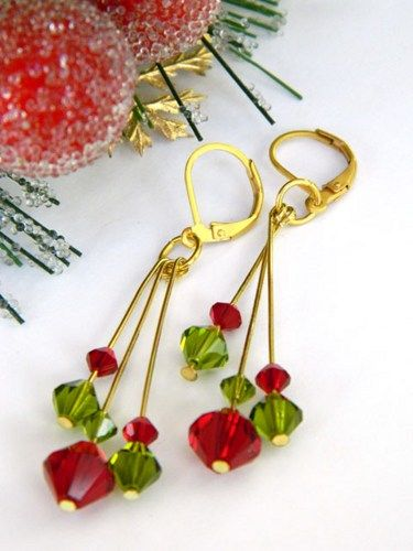 These beautiful Christmas earrings feature genuine Swarovski Austrian crystals in Siam red and fern green that dangle from gold plate headpins.  The long, handmade earrings have three headpins at diff