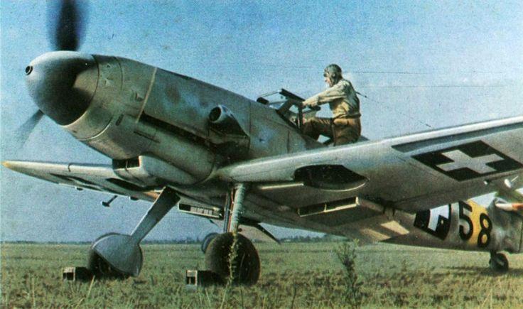 The pilot climbs into the cockpit of the Hungarian fighter Messerschmitt Bf.109F-4