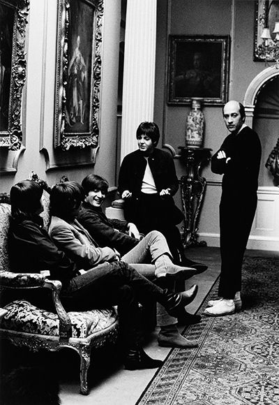 The Beatles with director Richard Lester in 1965 at Cliveden House during the filming of 'Help!'
