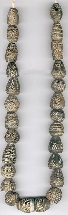 Strand of clay spindle whorls from Mali