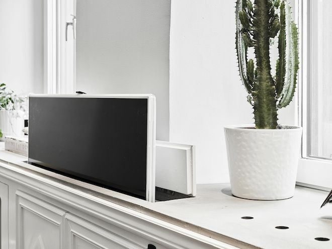 my scandinavian home: Artfully hidden TV in a lovely Swedish space