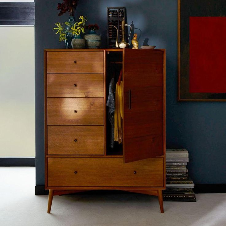 Just right. Smaller than an armoire and more accommodating than a chest of drawers, the Mid-Century Chifforobe is an all-in-one wardrobe for smaller spaces. It's crafted of FSC®-certified wood, adding modern-day sustainability to its timeless 1950s and '60s style.