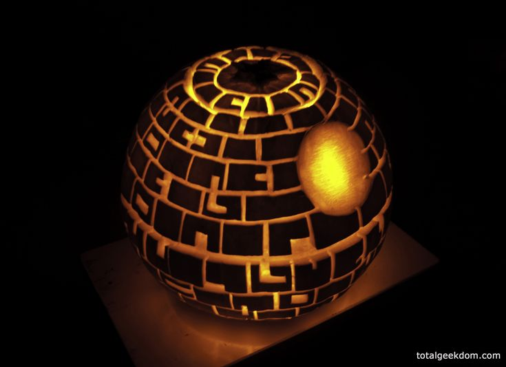 Whoa! Now that's an impressive pumpkin carving! Star Wars Death Star Pumpkin