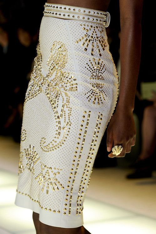 Versace Spring 2012. Now that's a skirt! I love the white subtle pattern material with the amazing golden studs all over, and creating the designs such as the seahorses. Truly art.