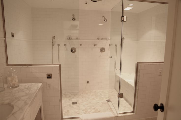 Would love to redo our bath and enclose the whole shower and bath area like this!..