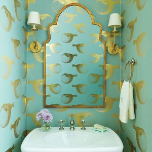 """""""My personality, the way I like to decorate, is a little whimsical,"""" says Elizabeth. """"And powder rooms are great places for doing something that's a little bit """"out there."""""""" Enter the aqua, watery world of a cheeky, gilded puffer fish """"swimming"""" around th"""