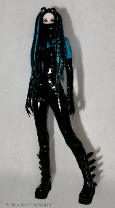 Cyber-Goth girl with a whole lot of latex, more fetish-Goth I think but striking.