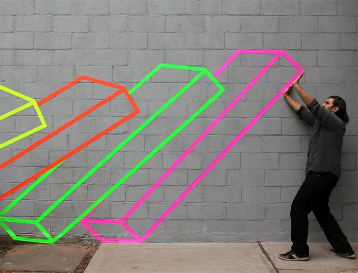 Cool graphic wall art using fluorescent tape!