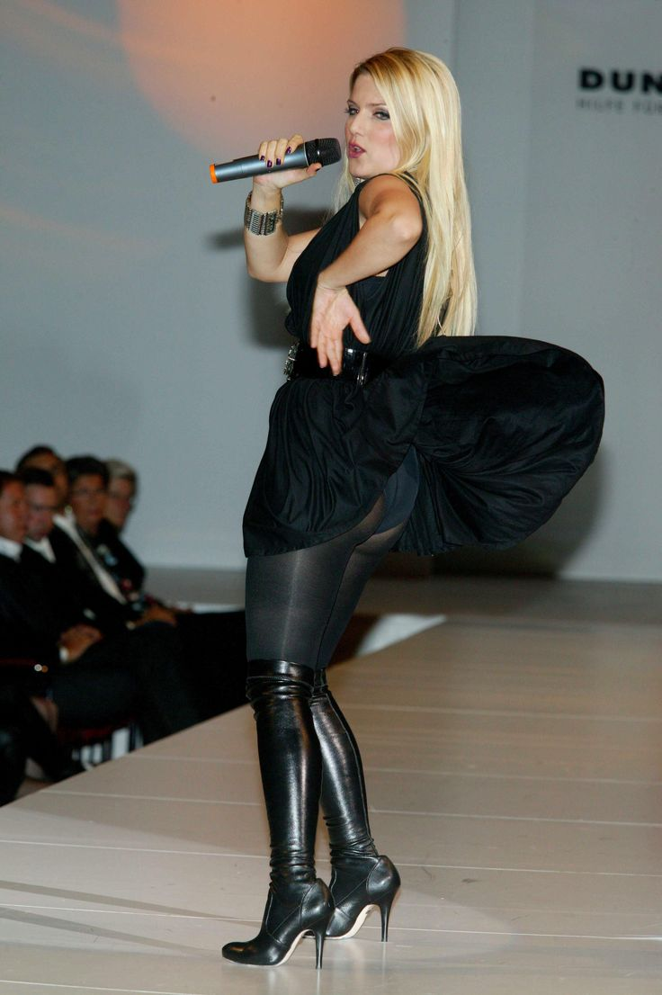 Jeanette biedermann in short black dress pantyhose and knee high heel boots with a upskirt