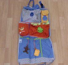 Organizador de coche con diferentes colores y departamentos para las herramientas de los niños y niñas. Imaginarium.