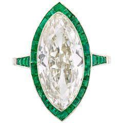Edwardian Marquise Diamond Ring with Calibre Emerald Border | From a unique collection of vintage engagement rings at https://www.1stdibs.com/jewelry/rings/engagement-rings/