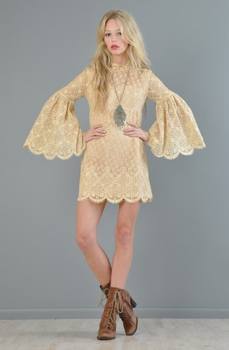 An amazing vintage 1970's crochet lace boho mini dress on eBay.