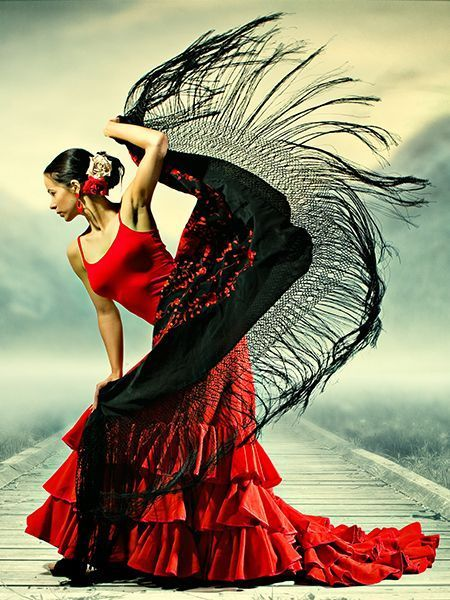 Elegant woman in a red flamenco dress, with a flying black shawl.                                                                                                                                                     Mais