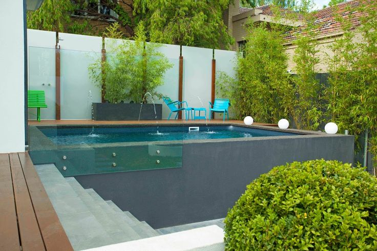 The swimming pool by Albatross Pools, with acrylic screens designed and built by Anthony Scott