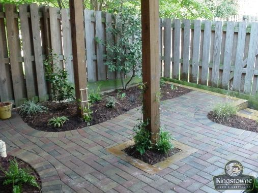 This paver patio was installed beneath a deck, in a townhome back yard.