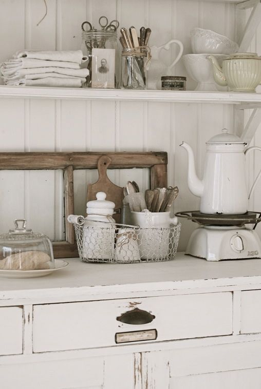 Vintage shabby kitchen. I like the wider planks on the wall - a nice change from traditional beadboard.