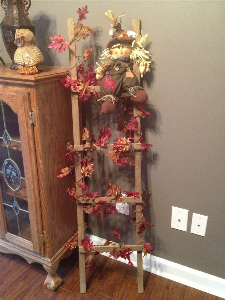 Fall leaves on tobacco stick ladder... thinking about doing this with my ladder,  Soooo cute!