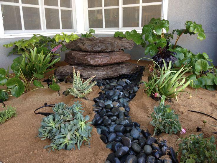 Boulder fountain dry river bed hawkeye landscape design for River stone garden designs