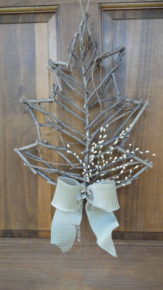 In love with this rustic twig leaf door hanging. Only $18 on Etsy! Decorative Fall Leaf with Crinkled Bow