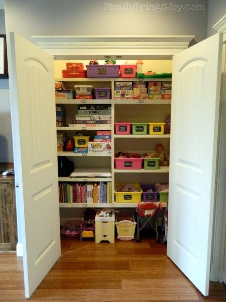 Playroom closet organization. Easy to see what is in there, with larger space on bottom for bigger items.