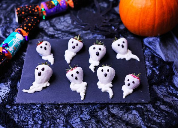 These friendly ghouls are really strawberries dipped in Greek yogurt – just use black icing for the features!