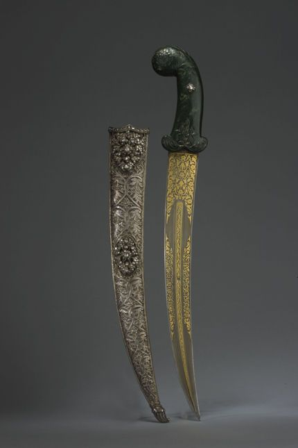 """Jade-hilted Dagger with gold-inlaid inscribed blade & diamond-set silver scabbard  Medium: Ottoman  Location: Turkey  Dated: circa 18th century  Inscriptions: The inscriptions include two couplets in Turkish and the Arabic:""""There is no youth [as brave as] 'Ali, no sword [as sharp as] dhi'l-faqar""""."""