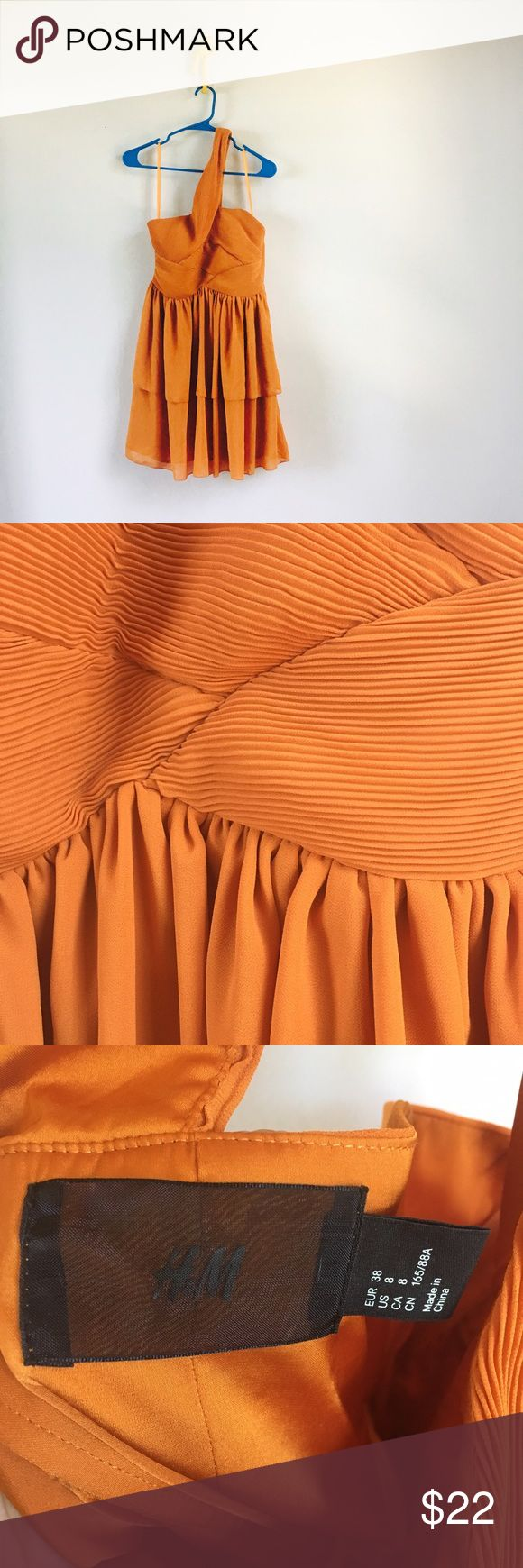 70s inspired H&M mini dress 70s inspired H&M size 8 mini dress. Retro orange. Fitted notice with pleat details. Cross-body single shoulder strap. Defined waistline. Flowing skirt. H&M Dresses One Shoulder
