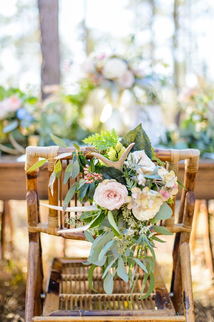 Beautiful Chair Decorations For This Rustic Romance Theme Sculptural Antlers Greenery And Florals