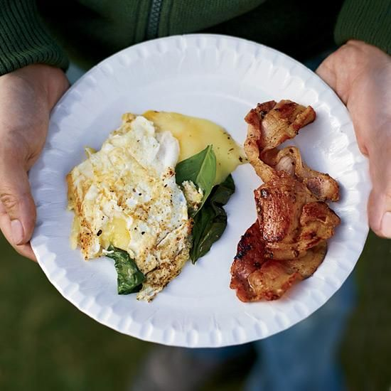 "Three-Egg Omelets with Whisky Bacon | ""I've been making a version of our 'hangover breakfast' since before I was old enough to drink,"" says Mark Canlis. He adds a little whisky to the bacon, along with brown sugar, to caramelize and flavor it. In Scotland, they use ""rashers,"" or ham-like Canadian bacon."
