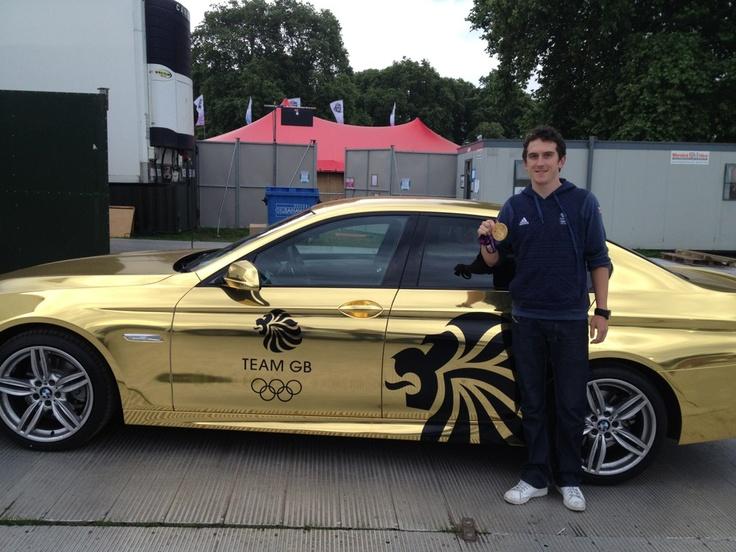 2012 - Geraint Thomas with a team GB car
