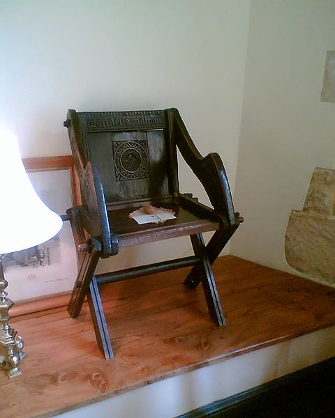 The original surviving Glastonbury chair, now in the Bishop's Palace, Wells. Early 16th century.