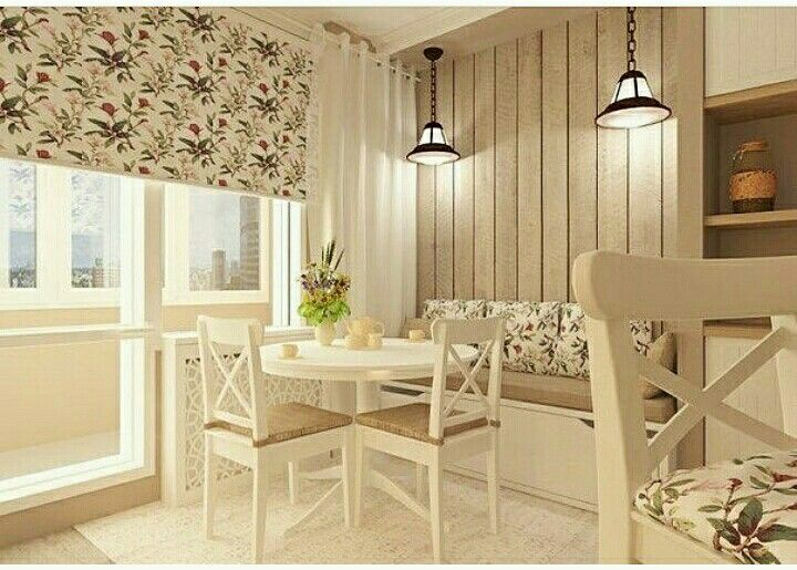 White kitchen table, chairs and banquette. Provance