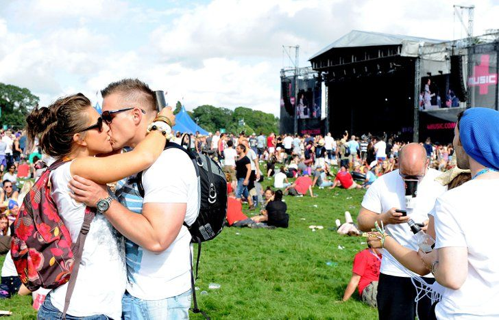 Pin for Later: Feel the Music Festival Love With These Cute Couples  Fans embraced at the V Festival at Weston Park in Staffordshire, England.