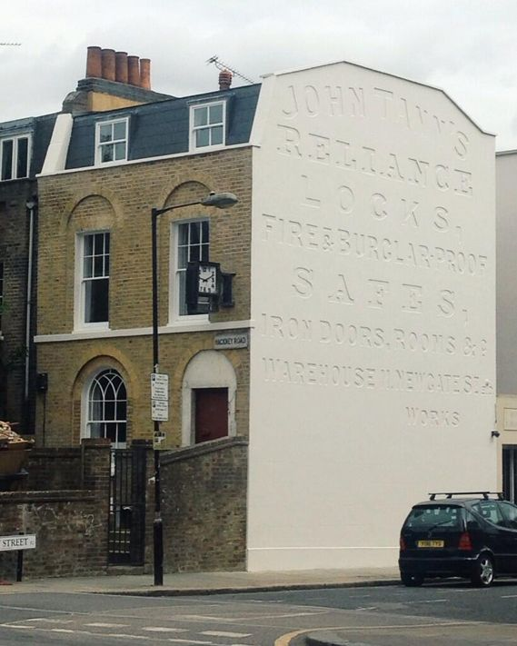 When a ghost sign comes back to life / Photograph by Katie Hall