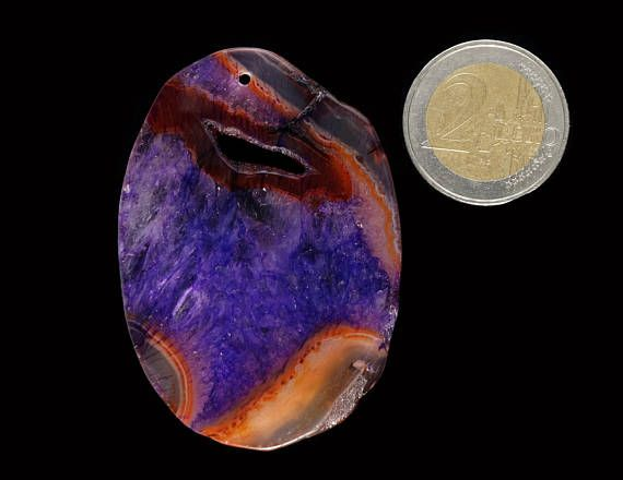 A unique purple orange druzy Agate pendant stone.  Size 62x44x7 mm  Refunds and Exchanges:  If you are not satisfied with your purchase for any reason, please contact me before leaving a feedback.  You can return purchased items without giving a reason within 14 days from the day you got it - just give me an information and send it to the address given below.   Shipping from Poland to destinations in Europe take about 7 days. Shipping to United States, Canada and Australia takes 10 - 20 days…