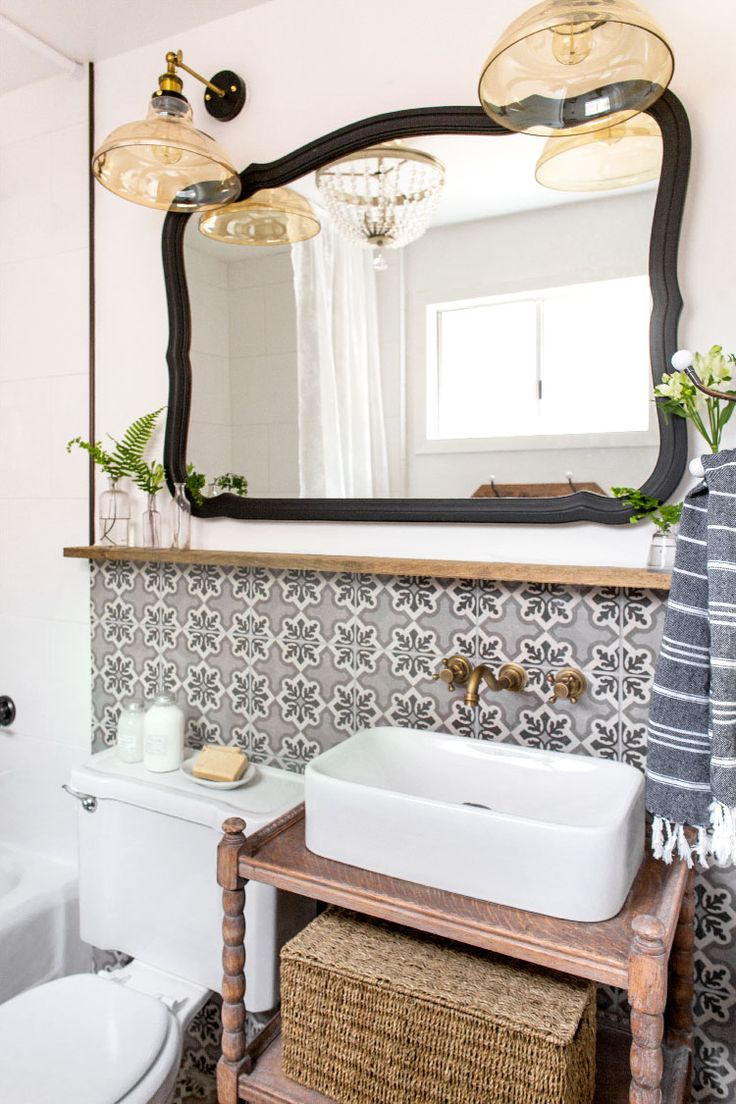 Bathroom: Cottage House Flip Reveal | Jenna Sue Design Blog I wanted a balance of wood tones and paint, so I ended up giving the vanity a light sanding and white wash treatment for a gently aged look, then painted the mirror in a matte black shade (using Maison Blanche's wrought iron).