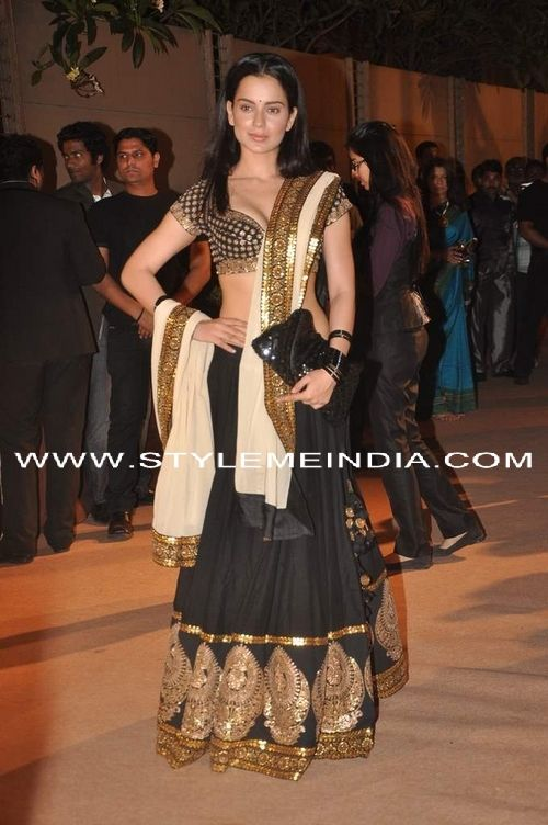 Actor Kangana Ranaut wears gorgeous Sabyasachi black & gold lehenga ensemble sans jewelry, and with straight hair: adventurous, beautiful