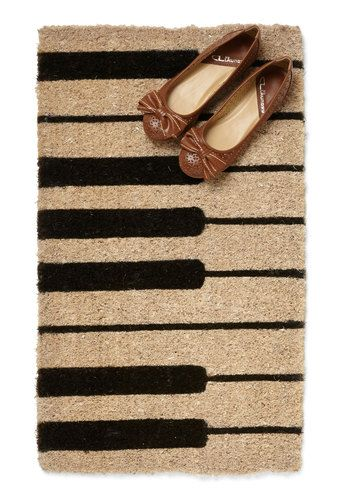 Whether you're hosting the performance of a string ensemble or throwing a dance party with a peppy brass band, it's clear that entertaining at home is your forte! Say, 'cello!' to scores of charmed guests by jazzing up your entryway with this piano doormat. Handcrafted from natural coir fiber, this durable piece is a playful prelude to your harmoniously decorated home. For a front step that makes a major impression, accompany your classical doorbell chime with this notable fifteen...