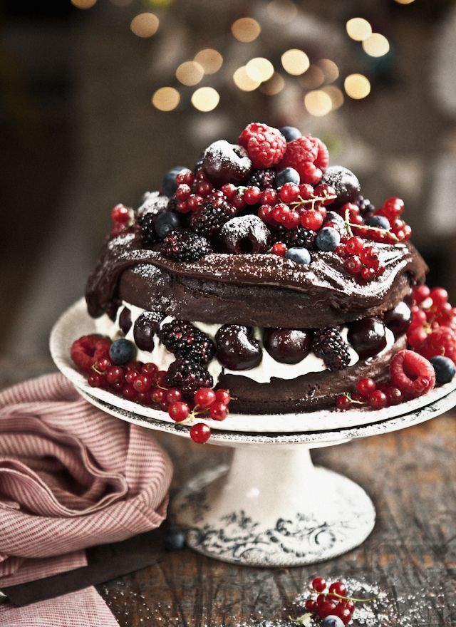 A decadent chocolate cake piled high with berries would be a dreamy Valentine's dessert.