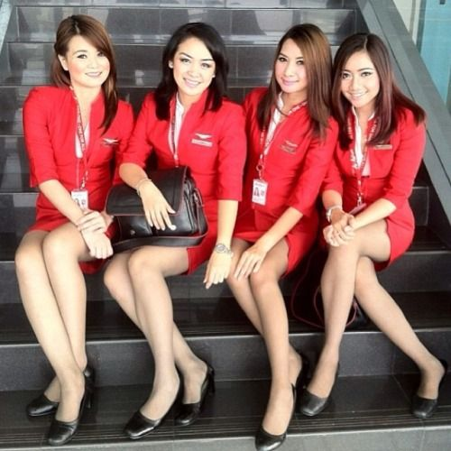 Misa Anthryayong (second left) holds a bag of counterfeit currency she confiscated from two fraudsters this Air Asia cabin crew caught on board their flight before handing it to police. Misa found the case stashed in the toilet after becoming suspicious of the men. Confronted by the stewardesses, the men admitted their guilt and surrendered. The girls bound both men securely with zip ties, later handing them over to police in Manila. They are in line for a reward from both bank and airline .