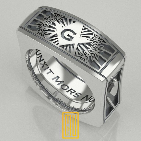 The Details of the Ring - A&FM 3. Degree symbols - Acacia, Square and compasses symbol with G - Virtus Junxit Mors Non Separabit is written inside - Momento Mori symbol - Trowel and pen symbol - Back side of the ring have black and white tiles The General Details: The rings are